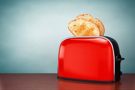 Old Style Photo. Toast popping out of Vintage Red Toaster on the table