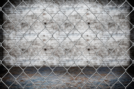 chained link fence: Wired fence pattern on grunge background Stock Photo