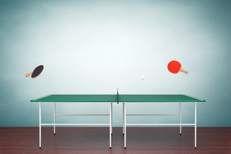 tennis net: Table tennis table with Paddles on the floor Stock Photo
