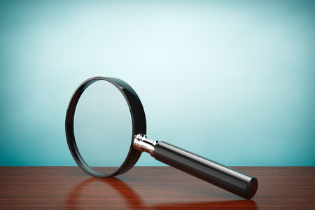 Old Style Photo. Magnifying Glass on the table Stock Photo