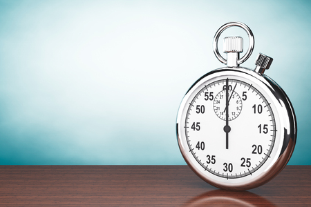 interval: Old Style Photo. Silver Stopwatch on the table Stock Photo