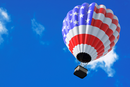 Hot Air Balloon as USA Flag in Flight on a sky background
