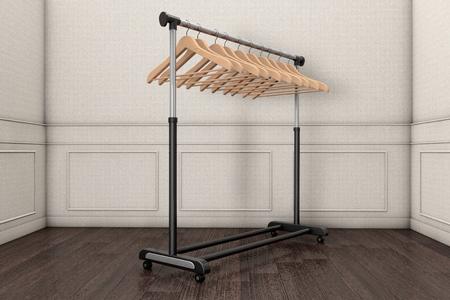 coat rack: Mobile black coat rack with hangers in front of a grey wall. 3d rendering