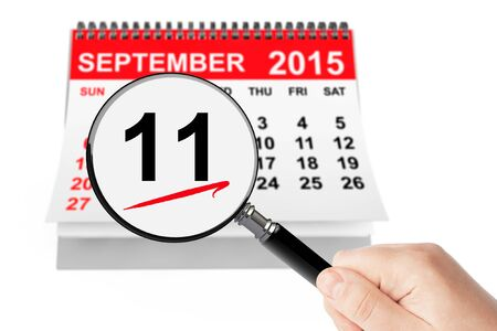 world trade center: 911 Never Forget Concept. 11 september 2015 calendar with magnifier on a white background