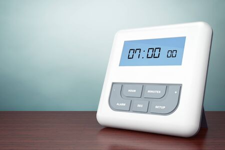 lcd display: Old Style Photo. Digital Alarm Clock with LCD Display on the table