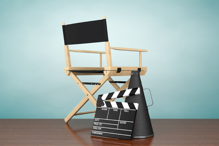filmmaker: Old Style Photo. Director Chair, Movie Clapper and Megaphone on the floor