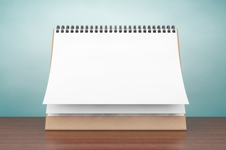 Old Style Photo. Blank paper desk spiral calendar on the table
