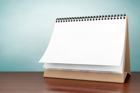 calendar day: Old Style Photo. Blank paper desk spiral calendar on the table