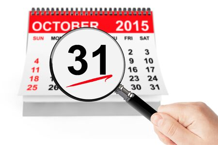 saints: All Saints Day Concept. 31 October 2015 calendar with magnifier on a white background
