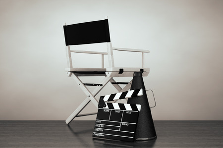 white board: Old Style Photo. Director Chair, Movie Clapper and Megaphone on the floor