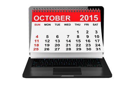 october calendar: 2015 año calendario. Calendario de octubre sobre la pantalla del portátil sobre un fondo blanco Foto de archivo
