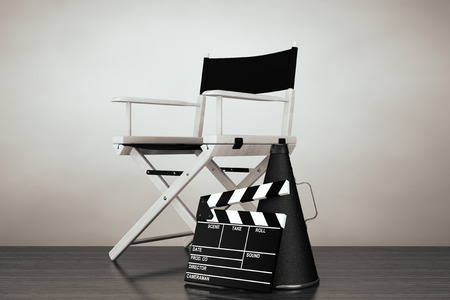 director chair: Old Style Photo. Director Chair, Movie Clapper and Megaphone on the floor