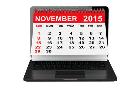 november calendar: 2015 year calendar. November calendar over laptop screen on a white background