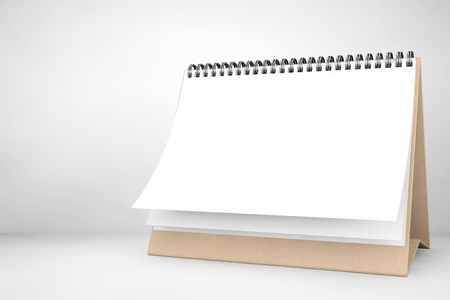 calendar day: Blank paper desk spiral calendar on the white background