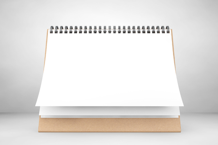 Blank paper desk spiral calendar on the white background