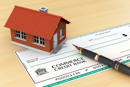 investment real state: Bank Check with House and pen on the table