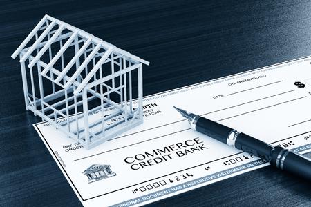 investment real state: Comprobar Banco con marco de Casa y la pluma sobre la mesa Foto de archivo