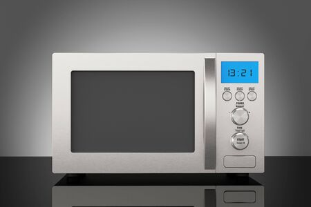 defrost: Modern Microwave Oven on the table