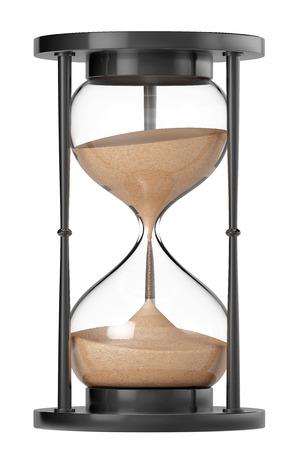 白い背景の上のクローズ アップ砂の砂時計
