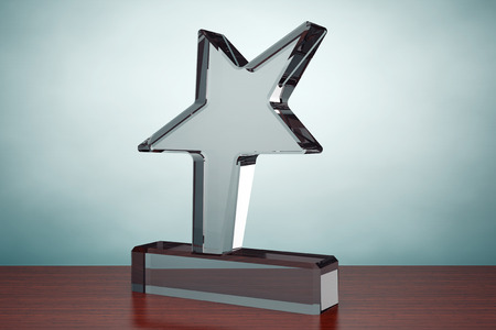 awards: Old Style Photo. Star Award Trophy on the table Stock Photo