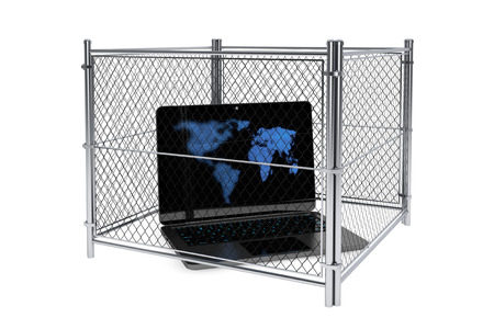 in bondage: Laptop inside a wired fence on a white background