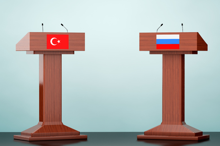 rostrum: Wooden Podium Tribune Rostrum Stands with Turkey and Russian flags on the floor Stock Photo