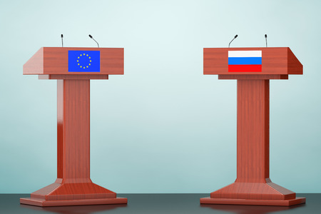 rostrum: Wooden Podium Tribune Rostrum Stands with European Union and Russian flags on the floor Stock Photo