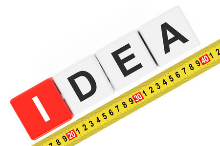 accomplishes: Measure Idea Concept. Ideas Cubes with Measuring Tape on a white background