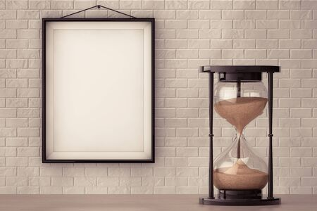 hourglass: Vintage Sand hourglass in front of Brick Wall with Blank Frame extreme closeup