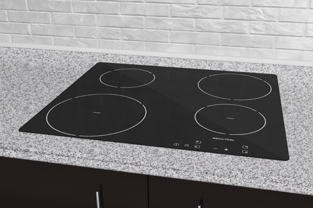 Induction cooktop stove with kitchen furniture 스톡 콘텐츠