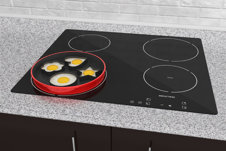 built: Cooking Eggs on Induction cooktop stove extreme closeup