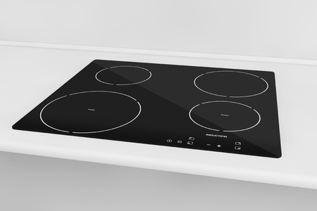 cooktop: Induction cooktop stove with kitchen furniture Stock Photo