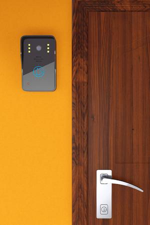 Moderno video citofono vicino Porta su una parete di fondo arancione Archivio Fotografico