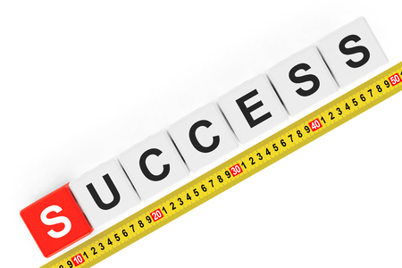 accomplishes: Masure Success Concept. Success Cubes with Measuring Tape on a white background Stock Photo