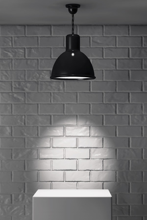brick: White Stand and Ceiling Lamp in front of brick wall Stock Photo