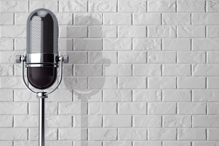 instrument cable: Vintage silver microphone in front of brick wall