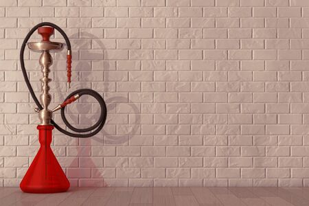 inhalation: Eastern Glass Hookah in front of brick wall Stock Photo