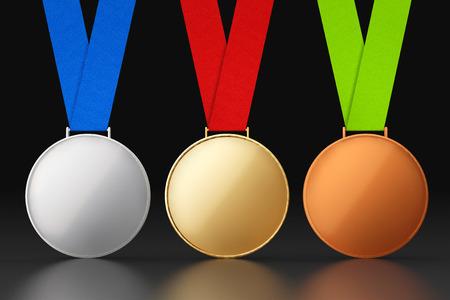 symbol sport: Gold, Silber und Bronze-Medaillen auf einem schwarzen Hintergrund