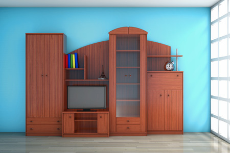 living room wall: Living Room Wall Unit in front of blue wall Stock Photo
