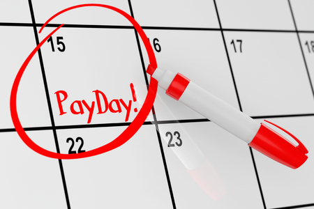 april 15: Payday Concept. Calendar with Red Marker and remind Payday Sign extreme closeup