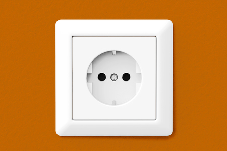 wallpaper wall: Power Electric Socket on a orange wallpaper wall Stock Photo