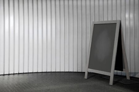 bordering: Blank Wooden Menu Blackboard Outdoor Display in front of wall Stock Photo