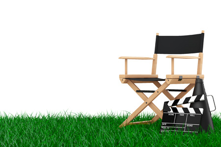 filmmaker: Director Chair, Movie Clapper and Megaphone over Grass on a white background. 3d Rendering