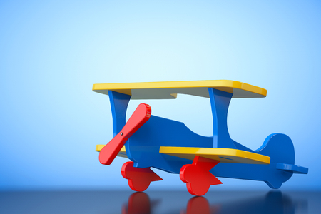 biplane: Toy Multicoloured Biplane on a blue background. 3d Rendering