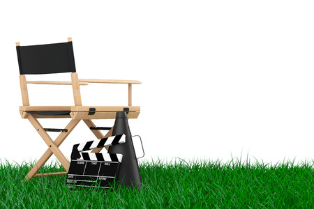 blockbuster: Director Chair, Movie Clapper and Megaphone over Grass on a white background. 3d Rendering