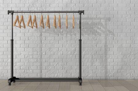 coat rack: Mobile Black Coat Rack with Hangers in front of Brick Wall. 3d Rendering