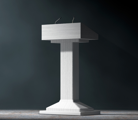tribune: White Podium Tribune Rostrum Stand with Microphones in the volumetric light on a black background. 3d Rendering Stock Photo