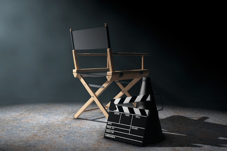 clapper board: Director Chair, Movie Clapper and Megaphone in the volumetric light on a black background. 3d Rendering