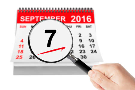 salami: Salami Day Concept. 7 september 2016 calendar with magnifier on a white background