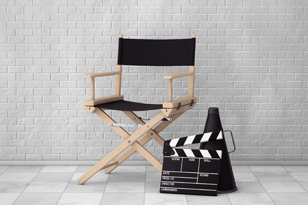 blockbuster: Director Chair, Movie Clapper and Megaphone in front of Brick Wall. 3d Rendering